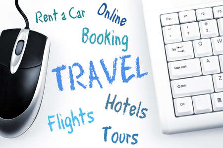 booking: Travel word scheme and computer keyboard