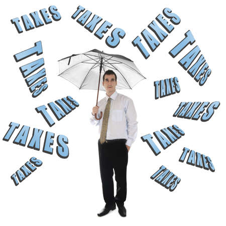 Taxes word and business man with umbrella photo