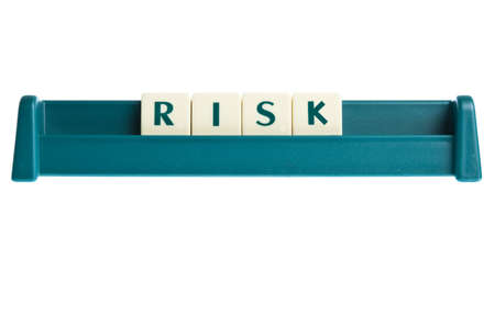 Risk word on isolated letters board photo