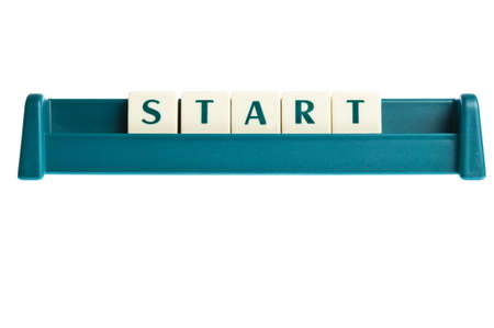 Start word on isolated letters board photo