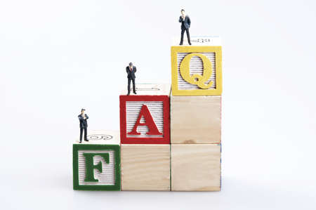 FAQ word and business man toy photo