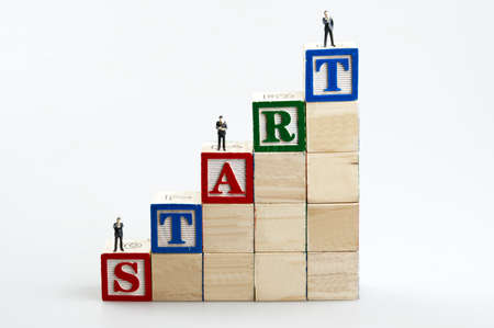Start word and business man toy Stock Photo - 11614913