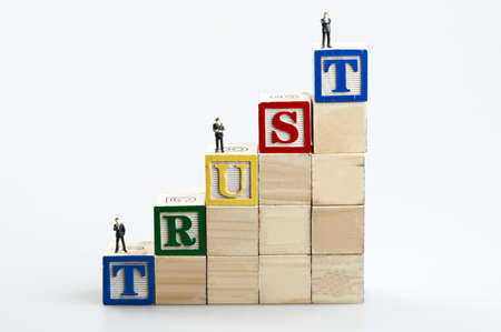 Trust word and business man toy photo