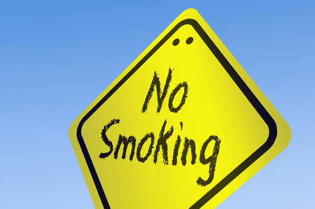 abstain: No Smoking word on road sign