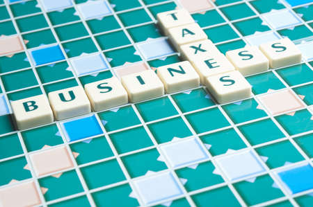 Business and taxes word made by letter pieces photo
