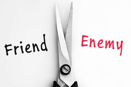 enemy: Friend and Enemy words with scissors in middle