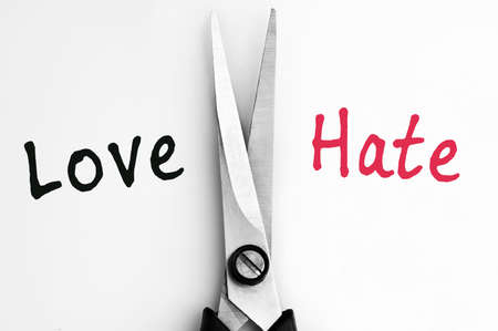 hate: Love and Hate words with scissors in middle