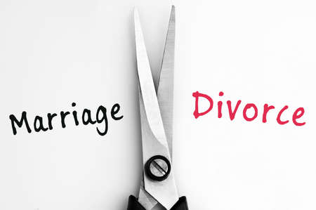 the split: Marriage and Divorce words with scissors in middle Stock Photo