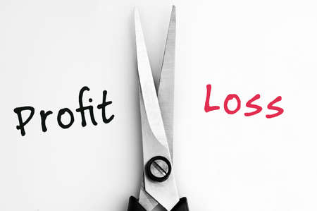 profit and loss: Profit and Loss words with scissors in middle Stock Photo
