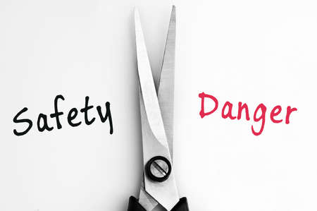 Safety and Danger words with scissors in middle Stock Photo - 11615434