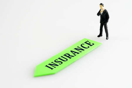 Insurance direction and toy business man Stock Photo - 11615323