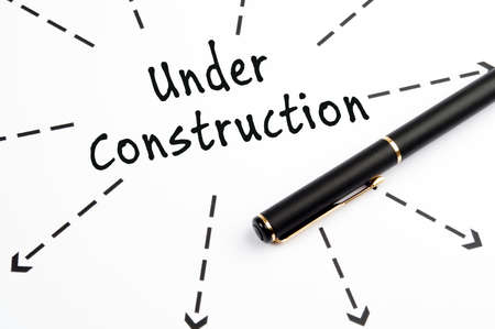 Under Construction word wih arrows and pen photo