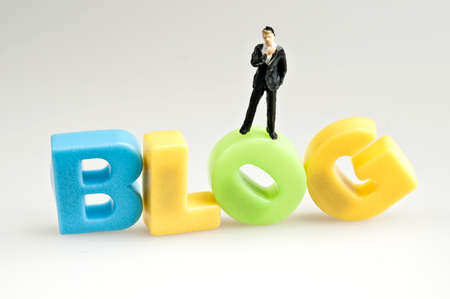 Blog word and toy business man photo