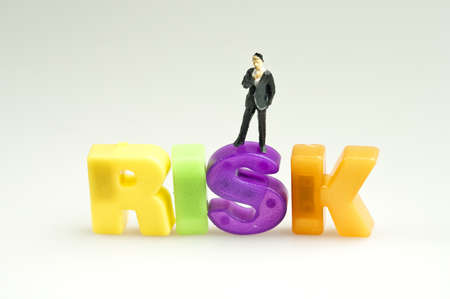 Risk word and toy business man photo