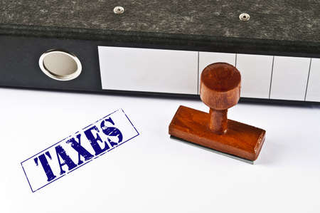 Taxes stamp on white paper photo