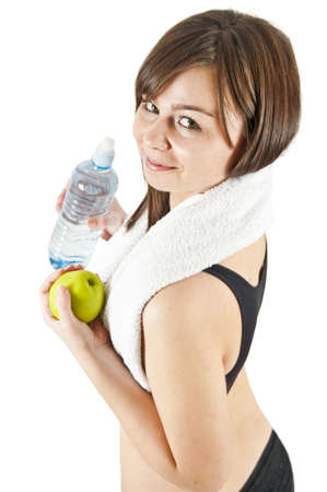 Isolated woman with apple after workout photo