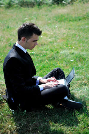 Business man with notebook in nature photo