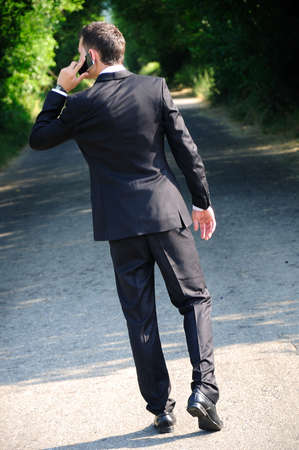 Business man with phone on road photo