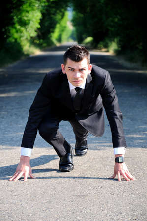 run way: Business man start running on road Stock Photo