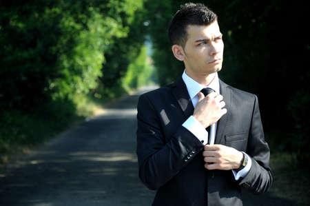 Business man arrange tie on road photo