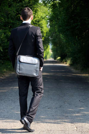 Business man walking on road Stock Photo