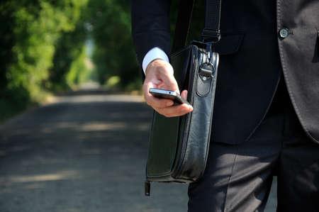 Business man walking on road photo