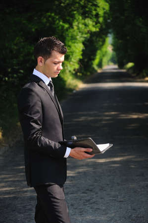 Business man read on road photo