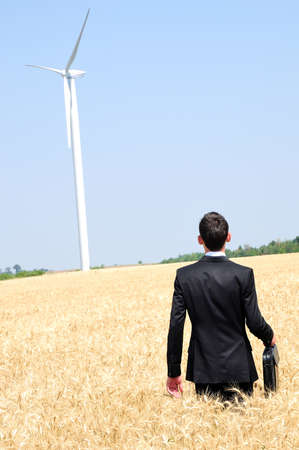 Business man walking in wheat photo