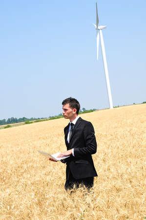 eolian: Business man standing in grain