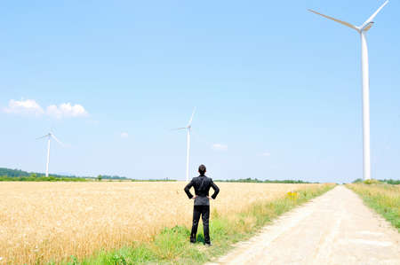 Business man at wind farm Stock Photo - 14465151