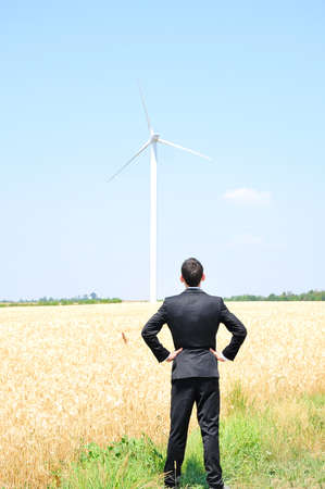 Business man at wind farm photo