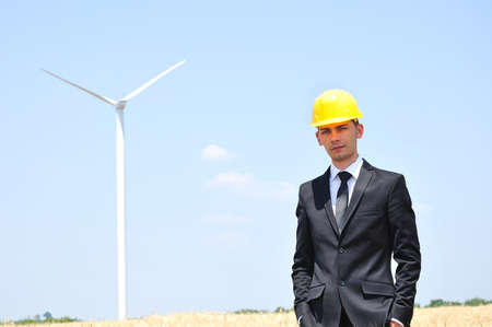 Young worker on wind farm  photo