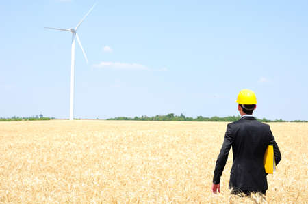 Young worker on wind farm  Stock Photo - 14465192