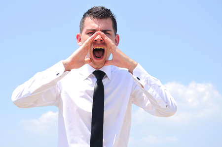 Business man closeup screaming outside Stock Photo - 14464414