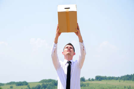 Business man delivery box in nature photo