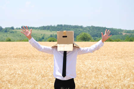 Business man hiding face with box photo
