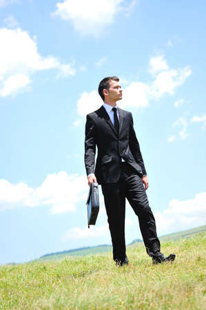 Business man walking in nature photo