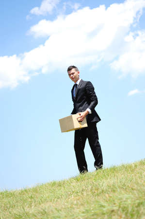 Business man delivering box in nature photo