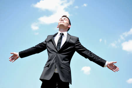 man looking at sky: Business man