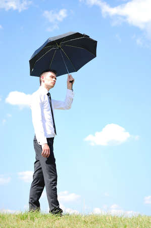 Business man with umbrella in nature photo
