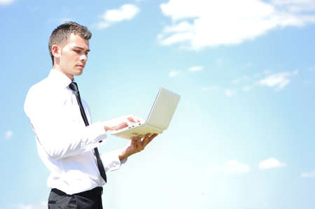 Business man with notebook on sky photo