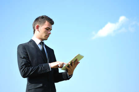 man waiting: Business man with tablet on sky