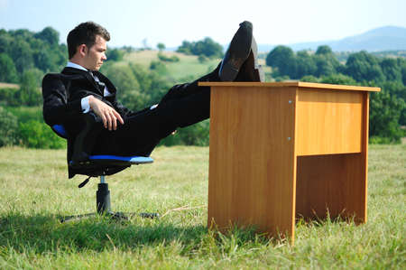 Business man at desk in nature photo