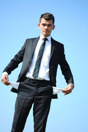 moneyless: Business man with empty pockets
