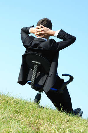 Business man on chair in nature photo