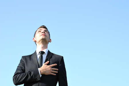 Business man with hand on heart Stock Photo
