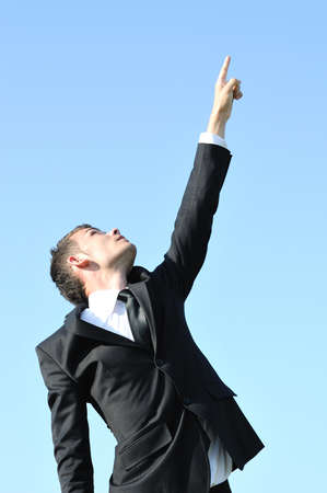 Business man pointing on sky photo