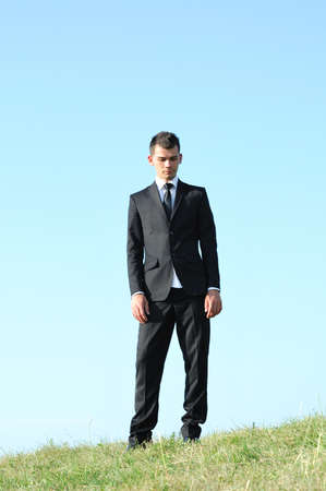 Business man standing in nature photo