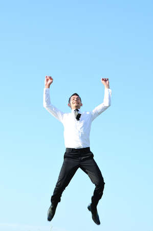 Business man jump at sky photo