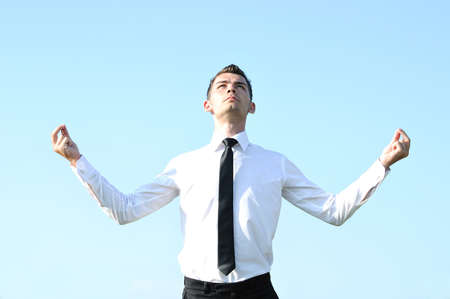 Business man pray at sky photo